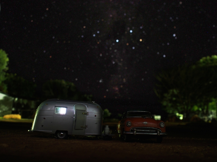 Nan hums a tune while she heats up a water bottle and pulls out their flannelette pajamas… it's chilly in the desert! Pops steps out to take a time-lapse shot of the stars above their caravan.